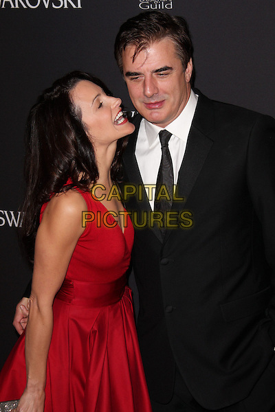 KRISTIN DAVIS & CHRIS NOTH.11th Annual Costume Designers Guild Awards at the Four Seasons Beverly Wilshire Hotel, Beverly Hills, California, USA..February 17th, 2009.headshot portrait red black suit jacket half funny face profile dress.CAP/ADM/CH.©Charles Harris/AdMedia/Capital Pictures