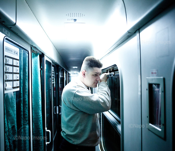 CENTRAL POLAND, FEBRUARY 2012:.Slawek at 5:30 in train to Warsaw. About 500 thousand people commute everyday from other towns and villages to work in the Polish capital..(Photo by Piotr Malecki / Napo Images)..Luty 2012:.Slawek o 5:30 w pociagu do Warszawy. Dojezdza ze Skierniewic. Okolo 500 tysiecy osob dojezdza codziennie z innych miast do pracy w Warszawie.  .Fot: Piotr Malecki / Napo Images