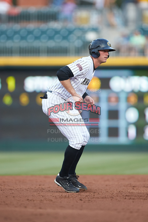 Michael Saunders (16) of the Charlotte Knights takes his lead off of second base against the Indianapolis Indians at BB&T BallPark on May 26, 2018 in Charlotte, North Carolina. The Indians defeated the Knights 6-2.  (Brian Westerholt/Four Seam Images)