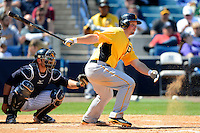 Pittsburgh Pirates first baseman Travis Snider #23 at bat in front of catcher Francisco Cerevelli during a Spring Training game against the New York Yankees at Legends Field on March 28, 2013 in Tampa, Florida.  (Mike Janes/Four Seam Images)