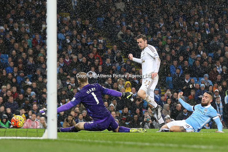 Gylfi Sigurdsson watches as his shot beats Joe Hart but goes wide of the post during the Barclays Premier League Match between Manchester City and Swansea City played at the Etihad Stadium, Manchester on 12th December 2015