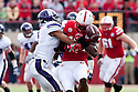 05 November 2011: Jeravin Matthews #3 of the Northwestern Wildcats forces Quincy Enunwa #18 of the Nebraska Cornhuskers to fumble after a catch in the second quarter at Memorial Stadium in Lincoln, Nebraska.  Northwestern defeated Nebraska 28 to 25.