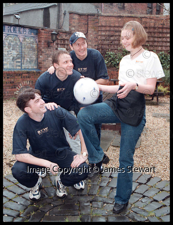 27th March 98      Copyright Pic : James Stewart   .FALKIRK PALYERS JAMIE MCGOWAN, DAVID HAGEN AND ANDY SEATON WATCH AS BEHIND THE WALL WAITRESS PAMILA DOYLE (correct spelling of pamila) SHOWS OFF HER BALL CONTROL SKILLS......... THE OWNERS OF BEHIND THE WALL HAVE AGREED TO PICK UP THE BILL FOR THE CLUB'S PRE-SEMI FINAL TRIP TO TROON NEXT WEEK, OTHERWISE THE PRESENT FINANCIAL PROBLEMS WOULD HAVE PREVENTED THEM FROM GOING.........Payments to :-.James Stewart Photo Agency, Stewart House, Stewart Road, Falkirk. FK2 7AS      Vat Reg No. 607 6932 25.Office : 01324 630007        Mobile : 0421 416997.If you require further information then contact Jim Stewart on any of the numbers above.........