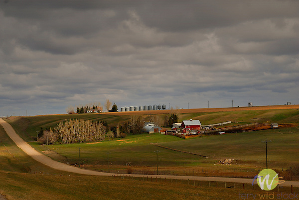Countryside of Carstairs, Alberta, Canada with road, farm, and silos.