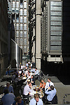 Lloyds Building City of London office workers lunch in the sunshine. UK