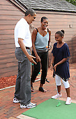 United States President Barack Obama and First Lady Michelle give thier daughter Sasha a high five after she got a hole in one at Pirate's Island Miniature Golf in Panama City Beach, Florida USA on Saturday, 14 August  2010.  The First Family is visiting the area to help promote tourism and check up on clean up efforts from the aftermath of the Deepwater Horizon Oil spill. .Credit: Dan Anderson / Pool via CNP