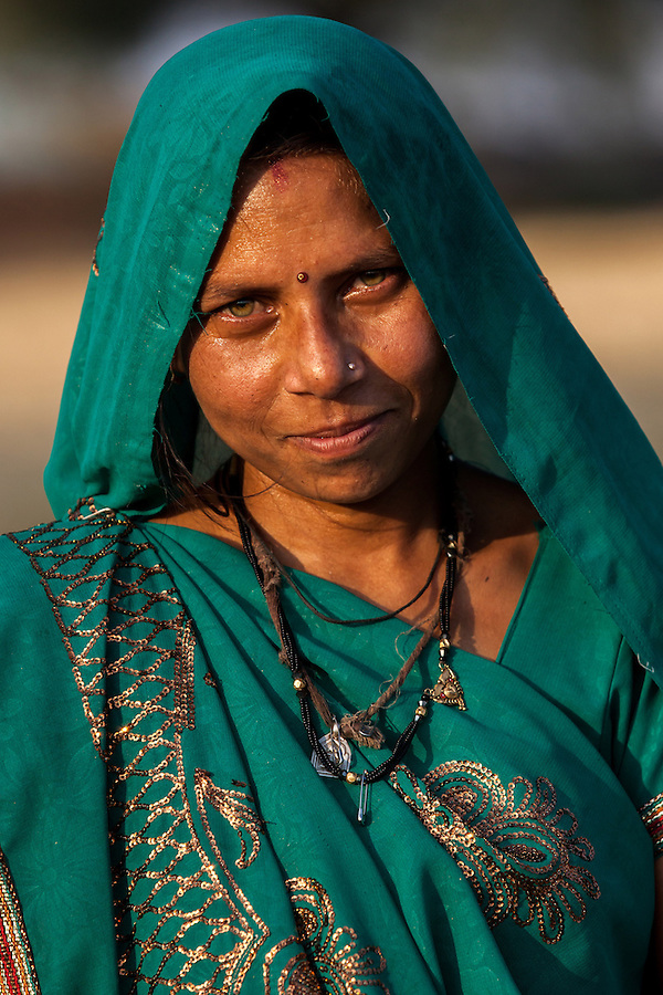 An agricultural worker is photographed in Bagdi, India.