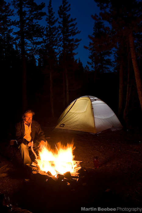 A man contemplates a campfire in Toiyabe National Forest, California