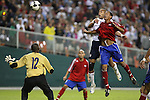 11 October 2008: Oguchi Onyewu (USA) (in white) outjumped a Cuba defender (right) and headed home the final goal over Odelin Molina (CUB) (12). The United States Men's National Team defeated Cuba Men's National Team 6-1 at RFK Stadium in Washington, DC in a CONCACAF semifinal round FIFA 2010 South Africa World Cup Qualifier.