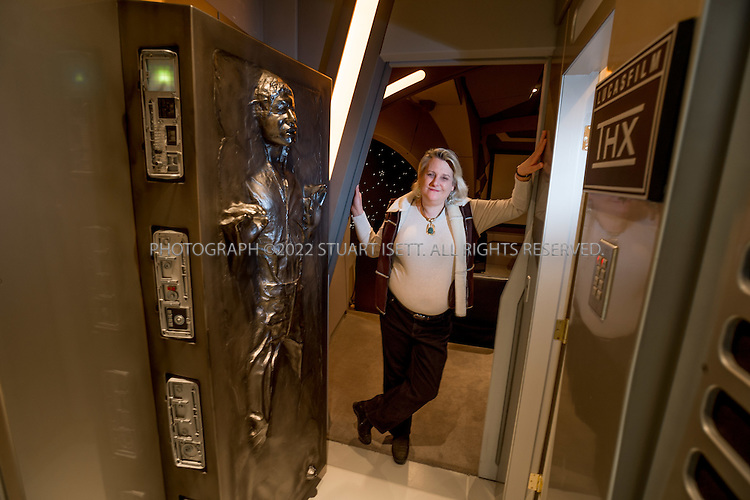 12/20/2012--North Bend, WA, USA..Lisa Stevens, CEO Paizo Publishing LLC at her home in North Bend, WASH. near Seattle. Ms. Stevens owns one of the largest private collections of Star Wars memerobilia in the world and has built a Star Wars space ship themed home cinema in her home...Lisa was born in Los Angeles, but raised mostly in the state of Wisconsin. She graduated from St. Olaf College in Northfield, MN with a degree in Biology, but forsook the academic life to start her first game company in 1987. Five years later, she ended up in Seattle, WA as one of the founders of Wizards of the Coast, a large game company best known for Magic: The Gathering, Dungeons and Dragons, and Pokémon. ..©2012 Stuart Isett. All rights reserved.