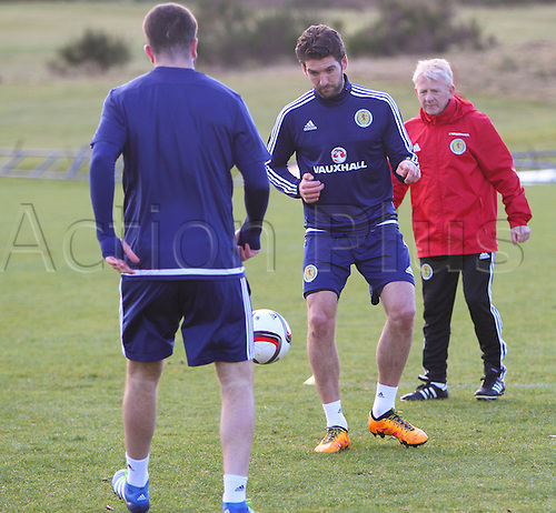 28.03.2016. Mar Hall, Glasgow, Scotland. International Football Scotland Training and Media Event. Gordon Strachan keeps a close eye on Grant Hanley and Charlie Mulgrew