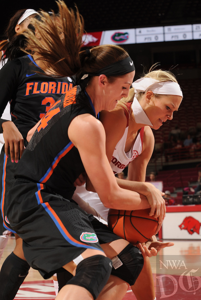 NWA Democrat-Gazette/ANDY SHUPE<br />Keiryn Swenson (right) of Arkansas and Haley Lorenzen of Florida grapple for a loose ball Thursday, Jan. 28, 2016, during the first half of play in Bud Walton Arena. Visit nwadg.com/photos to see more photographs from the game.