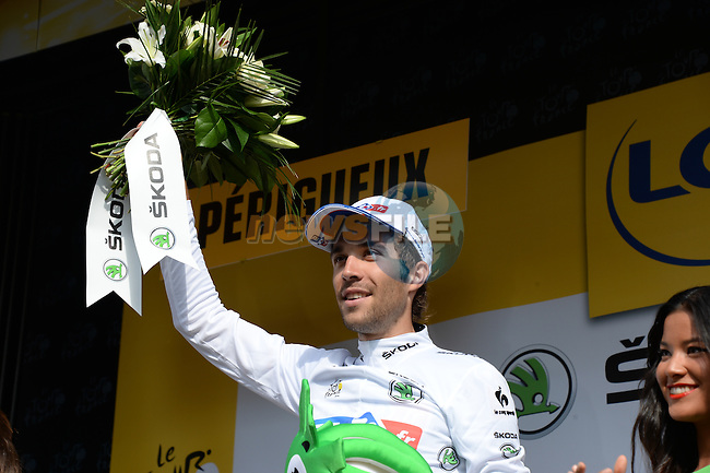 White Jersey leader Thibaut Pinot (FRA) FDJ.FR on the podium at the end of Stage 20 Individual Time Trial of the 2014 Tour de France running 54km from Bergerac to Perigueux. 25th July 2014.<br /> Photo ASO/X.Bourgois/www.newsfile.ie
