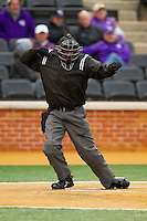 Home plate umpire Tyler Simpson calls a batter out on strikes during the game between the Western Carolina Catamounts and the Wake Forest Demon Deacons at Wake Forest Baseball Park on March 26, 2013 in Winston-Salem, North Carolina.  The Demon Deacons defeated the Catamounts 3-1.  (Brian Westerholt/Four Seam Images)