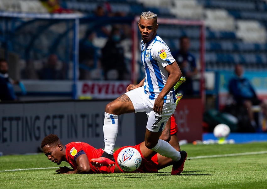 Huddersfield Town's Juninho Bacuna gets away from Wigan Athletic's Jamal Lowe <br /> <br /> Photographer Alex Dodd/CameraSport<br /> <br /> The EFL Sky Bet Championship - Huddersfield Town v Wigan Athletic - Saturday 20th June 2020 - John Smith's Stadium - Huddersfield <br /> <br /> World Copyright © 2020 CameraSport. All rights reserved. 43 Linden Ave. Countesthorpe. Leicester. England. LE8 5PG - Tel: +44 (0) 116 277 4147 - admin@camerasport.com - www.camerasport.com