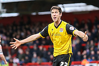 Luke Prosser of Northampton Town directs his frustration towards the Assistant Referee during the Sky Bet League 2 match between Stevenage and Northampton Town at the Lamex Stadium, Stevenage, England on 19 March 2016. Photo by David Horn / PRiME Media Images.
