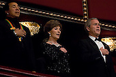 WASHINGTON, DC: U.S. President George Bush and First Lady Laura Bush are joined in singing the National Anthem by Kennedy Center Awards recipient, singer Smokey Robinson, left, as they celebrate the annual Kennedy Center Honors Gala, Sunday, December 3, 2006, in Washington, DC.  .(Photo by Chris Greenberg/POOL/Bloomberg News)