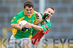 Ian Galvin  South Kerry shields the ball from John Divane Kilcummin in the Quarter finals of the Kerry Senior County Championship on Sunday at Fitxgerald Stadium, Killarney.