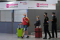 PALMA DE MALLORCA, SPAIN JUNE 15: Passengers from Dusseldorf Germany arrived at Palma de Mallorca airport, they are the first tourists to visit Spain since confinement began due to the COVID-19 crisis. The government of Spain has allowed the entry of 10,900 German tourists to the Balearic Islands on 47 flights throughout the entire month of June to test the viability of tourist recovery. (Photo by Joan Armengual/VIEWpress via Getty Images).