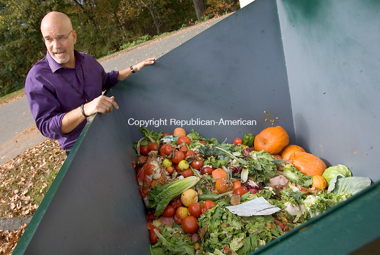 WOODBURY CT. 15 October 2013-101513SV11-Bob LaBonne Jr. looks over the produce recycling dumpster out back of the market in Woodbury Tuesday. <br /> Steven Valenti Republican-American
