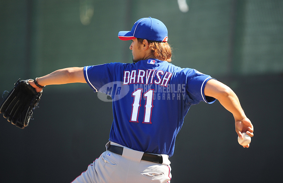 Mar. 2, 2012; Surprise, AZ, USA; Texas Rangers pitcher Yu Darvish during an intrasquad game on the practice fields at Surprise Stadium.  Mandatory Credit: Mark J. Rebilas-.