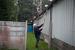 The home club's vice-chairman Chris Woolfall, retrieving a match balls from behind a stand at the Harry Williams Riverside Stadium, home to Ramsbottom United as they played Barwell in a Northern Premier League premier division match. This was the club's 13th league game of the season and they were still to record their first victory following a 3-1 defeat, watched by a crowd of 176. Rams bottom United were formed by Harry Williams, the current chairman, in 1966 and progressed from local amateur football  in Bury to the semi-professional leagues.