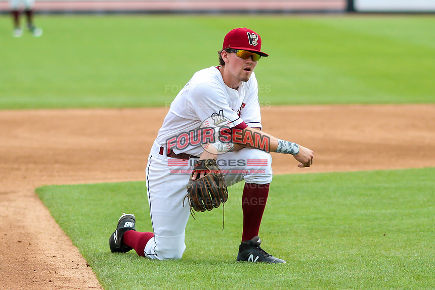Wisconsin Timber Rattlers shortstop Trever Morrison (13) takes a knee during an injury delay during a Midwest League game against the Bowling Green Hot Rods on July 23, 2018 at Fox Cities Stadium in Appleton, Wisconsin. Wisconsin defeated Bowling Green 5-3. (Brad Krause/Four Seam Images)