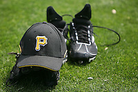February 26, 2009:  Glove, cleats and Pirates hat during Spring Training at Pirate City in Bradenton, FL.  Photo by:  Mike Janes/Four Seam Images