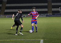 Lewis McLear takes on Eoghan O'Connell in the St Mirren v Celtic Clydesdale Bank Scottish Premier League U20 match played at St Mirren Park, Paisley on 18.12.12.