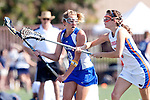 Santa Barbara, CA 02/13/10 - Maggie Aker (UCSB # 9) and Kate O'Linn (Florida # 6)in action during the UCSB-Florida game at the 2010 Santa Barbara Shoutout, UCSB defeated Florida 9-8.