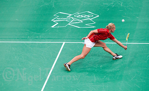 28 JUL 2012 - LONDON, GBR - Kamila Augustyn (POL) of Poland returns during her London 2012 Olympic Games women's singles badminton group match against Anastasia Prokopenko of Russia at Wembley Arena, London, Great Britain .(PHOTO (C) 2012 NIGEL FARROW)