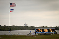 American flag and countdown morning of Endeavour's scrubbed launch about 3 1/2 hours before the 3:47 scheduled liftoff due to mechanical woes at Kennedy Space Center, Cape Canaveral, Florida, USA, April 29, 2011. Photo by Debi Pittman Wilkey