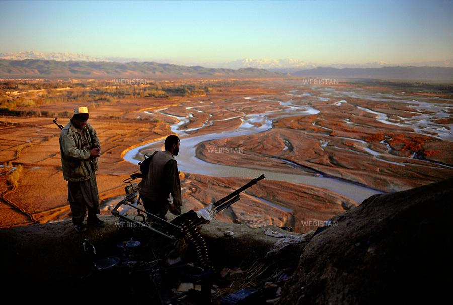 Afghanistan, Takhar, Dasht-e Qal'eh. November 2000.<br /> Near the border with Tajikistan, the Ai Khanoum hill marks the front line between Commandant Massoud's Northern Alliance and the Talibans on the other side of the River Kowkcheh. The Kowkcheh River.<br /> <br /> Afghanistan. Takhar. Dasht-e Ghala. Novembre 2000. <br /> Pr&Euml;s de la fronti&Euml;re avec le Tadjikistan, la colline d'A&Ocirc;-Khanoum repr&Egrave;sente la ligne de front entre l'Alliance du Nord de Massoud et l'arm&Egrave;e taliban, de l'autre c&Ugrave;t&Egrave; de la rivi&Euml;re Kouktcha. <br /> La rivi&Euml;re Kouktcha.