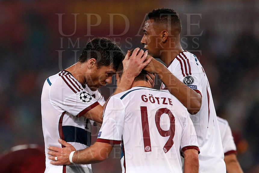 Calcio, Champions League, Gruppo E: Roma vs Bayern Monaco. Roma, stadio Olimpico, 21 ottobre 2014.<br /> Bayern&rsquo;s Mario Goetze, celebrates with teammates after scoring during the Group E Champions League football match between AS Roma and Bayern at Rome's Olympic stadium, 21 October 2014.<br /> UPDATE IMAGES PRESS/Isabella Bonotto