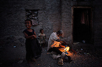 A family of somali refugees  gets ready for night in the Kharaz refugee camp In  Yemen on Tuesday November the 27th 2007. THe camp, former military barracks, hosts 9000 somali refugees, most of which have become stable residents, completely dependent on humanitarian donations.  Somalis are allowed to work in Yemen, but due to the a 35% unemployment rate in the country, most of them remain jobless.///..Ever since the collapse of the Siad Barre regime in 1991 Somali men, women and children have been arriving at the port of Bosasso to buy passage in small open fishing boats to Yemen, where they are given automatic political asylum..The  boat trip, costing from 70 to 150 usd per person, can be often fatal due to the roughness of the sea, the overcrowded boats and the merciless of the smugglers..On the night of Nov 29 2007 a small fishing boat while trying to download it's load of refugees a few hundred meters from the Yemeni  shores of Meifa Haja, flipped over and was overwhelmed by the constant waves. of its 130 passengers, only 42 reached the UNHCR ( United Nations High Commissioner for Refugees )  refugee center in Meifa. 30 bodies where recovered the next day.  the rest are still unaccounted for.. UNHCR  estimates more than 80.000 somali refugees live  in the country residing mostly in shanty towns in Sana'a' and Aden.
