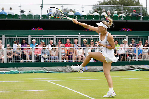 02.07.2015.  Wimbledon, England. The Wimbledon Tennis Championships.  Ladies' Singles second match between fifth seed Caroline Wozniacki (DEN) and Denisa Allertova (CZE).  Caroline Wozniacki in action with apparently yellow trimmed underwear - potentially running foul of the strict Wimbledon dress code