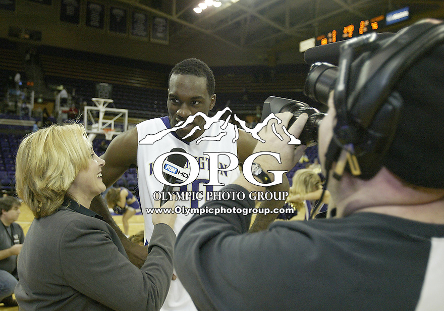 06 December 2009:  Washington Huskies #20 Quincy Pondexter interviews after the game with FSN reporter Angie Mentink after helping his team defeat California State Northridge. Washington won 88-76 over Cal State Northridge at the Bank of America Arena in Seattle, WA