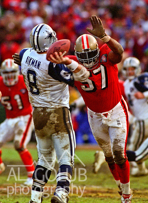 San Francisco 49ers vs. Dallas Cowboys at Candlestick Park Sunday, January 15, 1995.  49ers beat Cowboys 38-28.  Dallas Cowboys quarterback Troy Aikman (8) rushed by San Francisco 49ers linebacker Rickey Jackson (57).