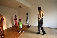 Mohamud Ali, with his wife Fadumo and five children, have a look around their newly purchased home in Manassas, Virginia. At 200,000 USD, the house was bought for half the price it would have been last year. The area is suffering from a major collapse in the housing market following the subprime crisis and global credit crunch, which has forced the foreclosure and abandonment of numerous properties...