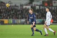 Christian Eriksen of Spurs & Tom Carroll of Swansea City during the Premier League match between Swansea City and Tottenham Hotspur at the Liberty Stadium, Swansea, Wales on 2 January 2018. Photo by Mark Hawkins / PRiME Media Images.