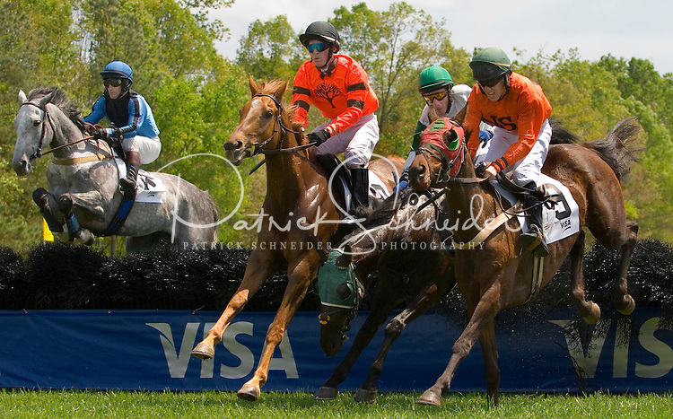 Jockey's land a jump during the Queen's Cup Steeplechase in Mineral Springs, NC.