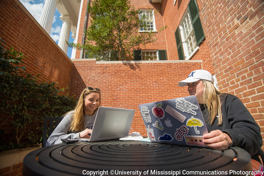Freshmen Gini James, right, and Alyssa Hepperich find an out of the way spot to wait for class and study. Photo by Kevin Bain/University Communications Photography