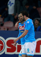 Calcio, Serie A: Napoli vs Juventus. Napoli, stadio San Paolo, 30 marzo 2014. <br /> Napoli forward Jose' Maria Callejon, of Spain, celebrates with teammate Gonzalo Higuain, of Argentina, right, after scoring during the Italian Serie A football match between Napoli and Juventus at Naples' San Paolo stadium, 30 March 2014.<br /> UPDATE IMAGES PRESS/Isabella Bonotto