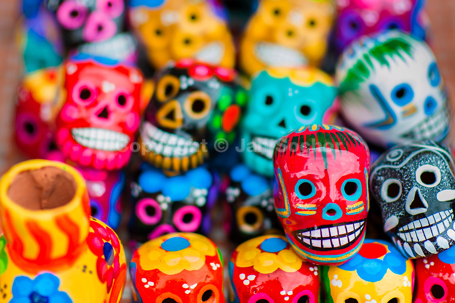 Colorful painted skulls are sold on the market during the Day of the Dead festival in Mexico City, Mexico, 28 October 2016. Skulls, skeletons and the other death symbols are used to adorn graves, altars and offerings during the Day of the Dead (Día de Muertos). A syncretic religious holiday, combining the death veneration rituals of the ancient Aztec culture with the Catholic practice, is celebrated throughout all Mexico. Based on the belief that the souls of the departed may come back to this world on that day, people gather at the gravesites in cemeteries, praying, drinking and playing music, to joyfully remember friends or family members who have died and to support their souls on the spiritual journey.