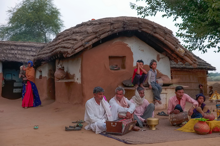 Using basic instruments, a small band provides dance and musical entertainment for visitors at a Meena village in Rajasthan.