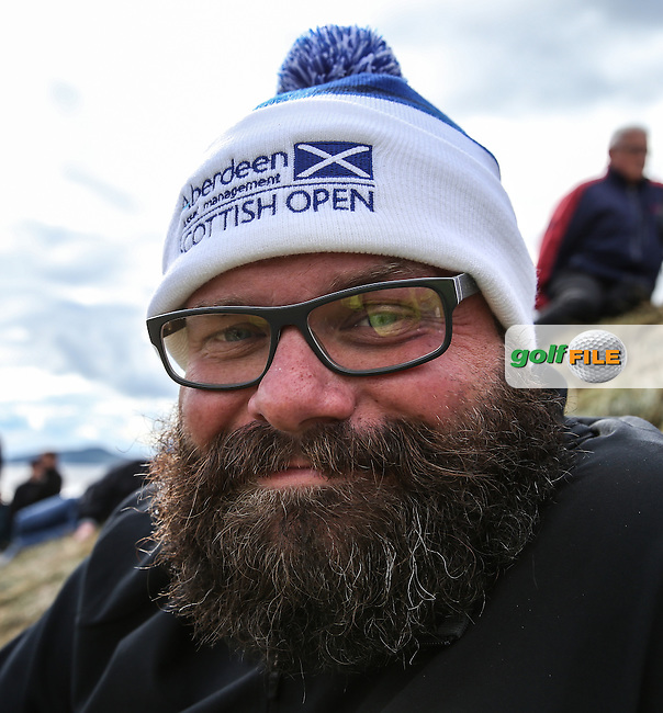 Local happy face wearing event bobble hat, during Round Two of the 2016 Aberdeen Asset Management Scottish Open, played at Castle Stuart Golf Club, Inverness, Scotland. 08/07/2016. Picture: David Lloyd | Golffile.<br /> <br /> All photos usage must carry mandatory copyright credit (&copy; Golffile | David Lloyd)