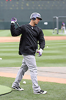 Carlos Gonzalez #5 of the Colorado Rockies participates in spring training workouts at Salt River Fields on February 26, 2011  in Scottsdale, Arizona. .Photo by:  Bill Mitchell/Four Seam Images.