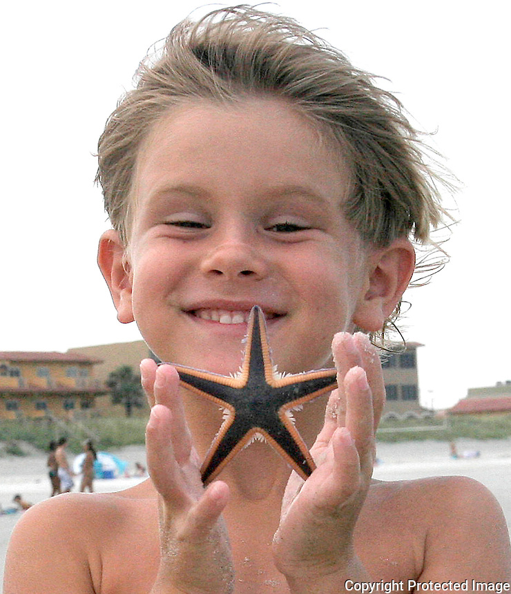 Gary Wilcox/StaffÉ. 06/18/08É Zachery Blizzard age 6 of Neptune Beach holds up a starfish he found while enjoying the nice weather at Jacksonville Beach last Tuesday. (06/18/08)....