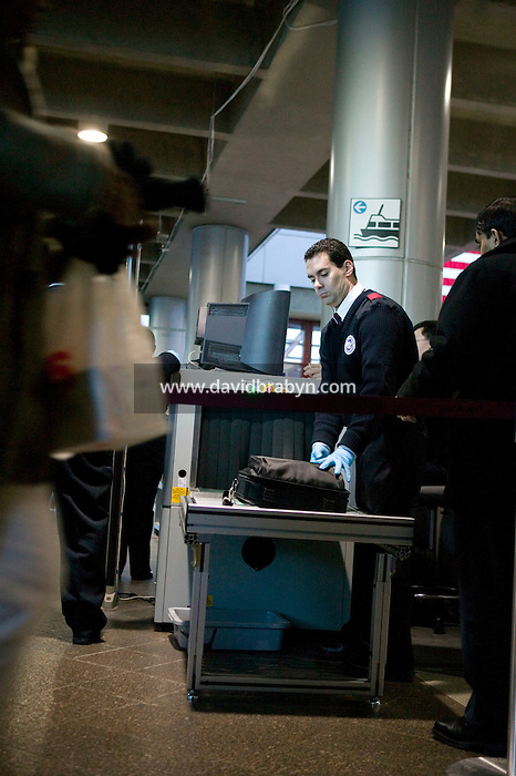 9 February 2006 - Jersey City, NJ - Port Authority of New York and New Jersey and Homeland Security personel test an airport-style screening system on people with large luggage pieces entering the PATH Exchange Place station in Jersey City, USA, to board the underground train going to Manhattan, 9 February 2006. Photo Credit: David Brabyn.