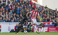 Eric Bailly of Man Utd & Jese of Stoke City during the Premier League match between Stoke City and Manchester United at the Britannia Stadium, Stoke-on-Trent, England on 9 September 2017. Photo by Andy Rowland.